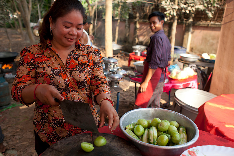 Cook at a buddhist wedding in a small village outside of Phnom Penh, Cambodia. <br /> <br /> Photos &copy; Dennis Drenner 2013.