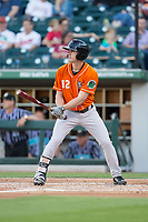 Logan Schafer (12) of the Norfolk Tides at bat against the Charlotte Knights at BB&T BallPark on May 2, 2017 in Charlotte, North Carolina.  The Knights defeated the Tides 8-3.  (Brian Westerholt/Four Seam Images)