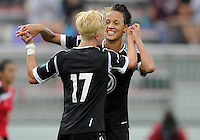BOYDS, MARYLAND - July 21, 2012:  Lianne Sanderson (10) of DC United Women congratulates Joanna Lohman (17) for scoring the third goal against the Virginia Beach Piranhas during a W League Eastern Conference Championship semi final match at Maryland Soccerplex, in Boyds, Maryland on July 21. DC United Women won 3-0.