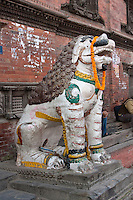 Kathmandu, Nepal.  Mythical figure guards the entrance to the Kumari Bahal, House of the Kumari Devi, a Young Girl Revered as a Living Goddess.  This house was built in 1757 in the style of a Buddhist vihara, a monastic abode.