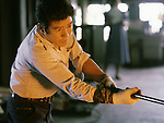 An artisan works near the factory's blast furnances at the Hokuyo Glass Manufacturing Company's  Blown Glass Factory in Aomori, Japan. Glass blowers at the factory churn out between 1,500 and 2,000 pieces of glass daily. (Jim Bryant Photo).....