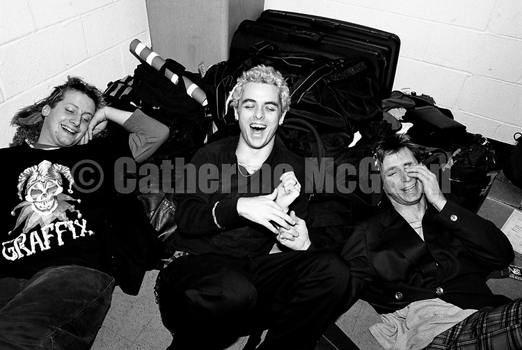 NEW YORK - 1994:  Green Day (L-R: Tre Cool, Billie Joe Armstrong and Mike Dirnt) laugh while posing for a portrait backstage at Madison Square Garden in 1994 in New York City, New York. (Photo by Catherine McGann).Copyright 2010 Catherine McGann