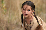 A green-eyed young Native American Indian boy portrait