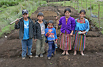 School children pose as they prepare garden plots and plant vegetables in San Jose la Frontera, a small Mam-speaking Maya village in Comitancillo, Guatemala. The program is jointly sponsored by the community's school and the Maya Mam Association for Investigation and Development (AMMID).