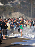20 June 2006: Hundreds of people gather on the sand to watch the South swell reaches the famous surf spot in Newport Beach, CA called The Wedge.  Surfers, boogie boarders, body surfers and crowds gather to watch the powerful waves and the waters take shape into unique sets along the jetty in Orange County, California.