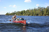 Gary paddles his fully-loaded Souris River Quetico 18 canoe during a resupply rendezvous. Basswood Lake has a reputation for rough waters.