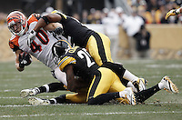 PITTSBURGH, PA - DECEMBER 04:  Brian Leonard #40 of the Cincinnati Bengals is tackled by members of the Pittsburgh Steelers defense during the game on December 4, 2011 at Heinz Field in Pittsburgh, Pennsylvania.  (Photo by Jared Wickerham/Getty Images)