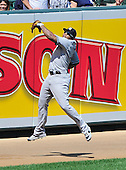 New York Yankees left fielder Andruw Jones (18) leaps in a vain attempt to catch a ball from the bat of Baltimore Orioles catcher Matt Weiters that went for a double in the second inning at Oriole Park at Camden Yards in Baltimore, Maryland in the first game of a doubleheader on Sunday, August 28, 2011.  .Credit: Ron Sachs / CNP.(RESTRICTION: NO New York or New Jersey Newspapers or newspapers within a 75 mile radius of New York City)