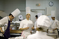 Students listen to the early morning class briefing at the Ecole Superieure de Cuisine Francaise Gregoire Ferrandi cooking school in Paris, France, 18 December 2007.