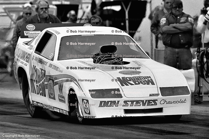 GAINESVILLE, FL - MARCH 13: John Force drives his Funny Car during the NHRA race on March 13, 1983, at the Gainesville Raceway near Gainesville, Florida.