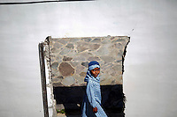 """A girl is seen through the doors of a house damaged in 2004 tsunami and left as a part of monument in Banda Aceh December 12, 2012. The gates of the memorial close for every of Muslim's five daily prayers and visitors are urged to go to local mosque. Some residents near the sea, together with many others including some local ulama, believe devastating 2004 tsunami that killed 170.000 people in Aceh province was the punishment from the God for those who broke Islamic laws and fear it might happen again. Indonesia is the world's most populous Muslim nation, but nowhere is the faith more strictly interpreted than in Aceh, sometimes referred to as the """"verandah of Mecca"""" because it was one of the first parts of the archipelago to turn to Islam. Aceh is Indonesia's only province to have implemented Sharia or Islamic laws.    REUTERS/Damir Sagolj (INDONESIA)"""