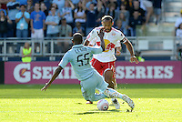 Red Bull forward Thierry Henry (14) tackled by Sporting KC midfielder Julio Cesar (55)...Sporting Kansas City defeated New York Red Bulls 2-0 at LIVESTRONG Sporting Park, Kansas City, Kansas.