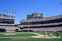 OAKLAND, CA - General stadium overall view of the Oakland Coliseum with Jason Giambi at bat during a baseball game involving the Oakland Athletics in 1997 in Oakland, California. Photo by Brad Mangin