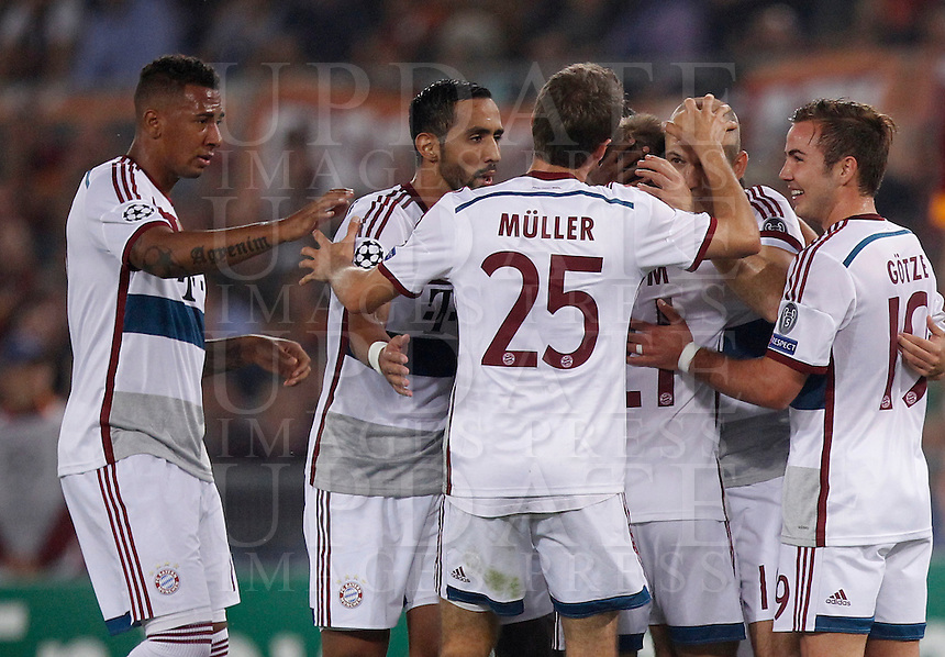 Calcio, Champions League, Gruppo E: Roma vs Bayern Monaco. Roma, stadio Olimpico, 21 ottobre 2014.<br /> Bayern&rsquo;s Arjen Robben, second from right, celebrates with teammates after scoring during the Group E Champions League football match between AS Roma and Bayern at Rome's Olympic stadium, 21 October 2014.<br /> UPDATE IMAGES PRESS/Isabella Bonotto