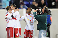 Juan Pablo Angel (9) of the New York Red Bulls celebrates scoring with Joel Lindpere (20) and Dane Richards (19). The New York Red Bulls defeated FC Dallas 2-1 during a Major League Soccer (MLS) match at Red Bull Arena in Harrison, NJ, on April 17, 2010.