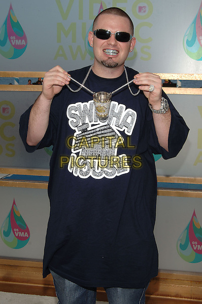 PAUL WALL.MTV Video Music Awards.Arrivals held at the American Airlines Arena,.Miami, 28th August 2005.half length silver chain pendant teeth sunglasses diamond dimante t-shirt.Ref: ADM/JW.www.capitalpictures.com.sales@capitalpictures.com.© Capital Pictures.