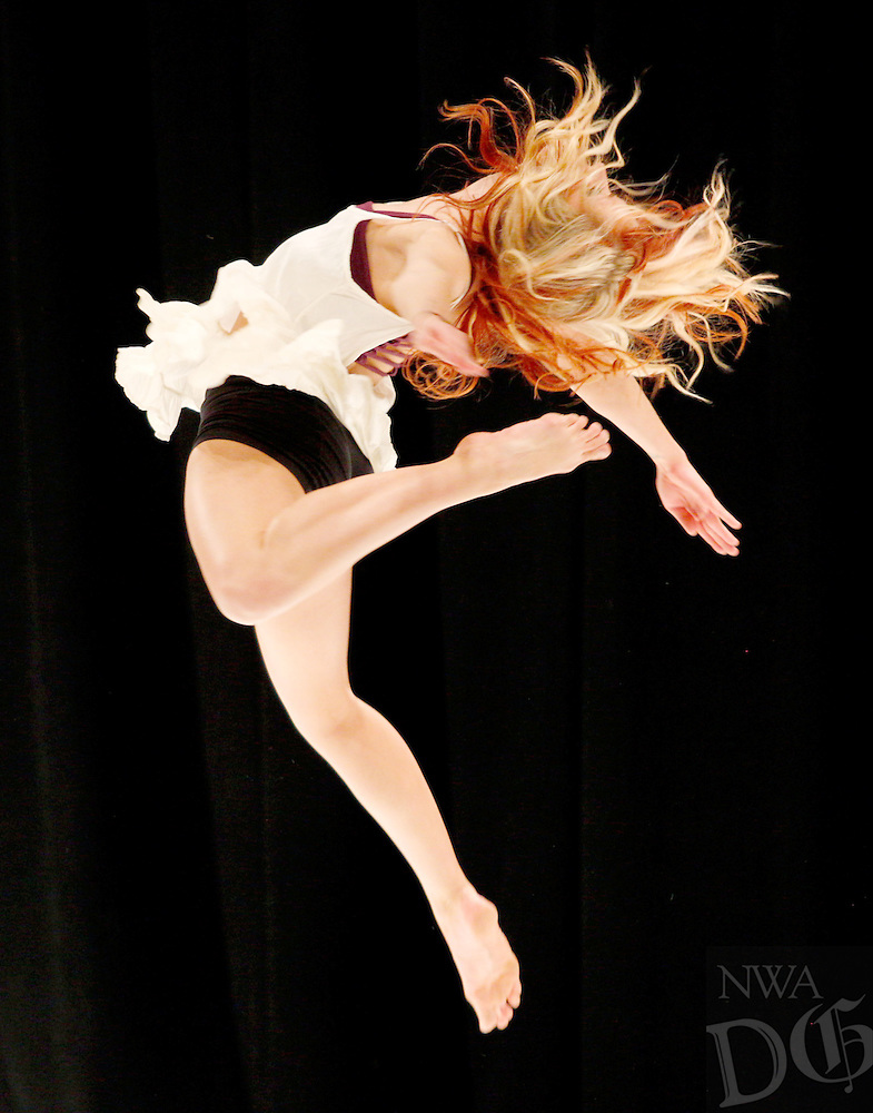STAFF PHOTO JASON IVESTER --05-15-2014--<br /> Benton County School of the Arts senior Mikayla McGuire performs a dance on stage during the school's Senior Night on Thursday, May 15, 2014, inside the school's Performing Arts Center in Rogers.