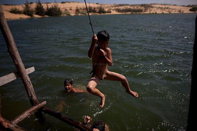 Local Vietnamese children play in the water in Mui Ne.
