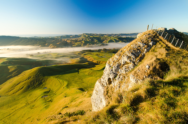Te Mata Peak at sunrise. Mist filled valley, Hawkes Bay, North Island, New Zealand