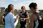 The Idaho Statesman reporter Rachel Roberts interviews Jordon Wallin, member of Rocky Mountain' s 4x800 meter relay team, during the 5A Idaho Track and Field Championships on May 18, 2012 at Rocky Mountain High School, Meridian, Idaho. Rocky Mountain finished first in the event with a time of 7:56.89.
