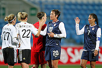 US's Abby Wambach and Shannon Boxx shake hands  with Germany's Jennifer Cramer, Luisa Wensing and Nadine Angerer during their Algarve Women's Cup soccer match at Algarve stadium in Faro, March 13, 2013.  .Paulo Cordeiro/ISI