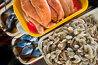 Wide variety of seafood, including fresh shrimps and uncooked fish roe sacs, is seen at Chorrillos seafood and fish market in Lima, Peru, 31 March 2013.