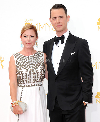 LOS ANGELES, CA - AUGUST 25: (L-R) Jamie Brewer and Colin Hanks arrive at the 66th Primetime Emmy Awards at Nokia Theatre L.A. Live on August 25, 2014 in Los Angeles, California.SKPG/MediaPunch