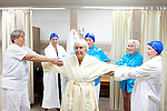 Members of the Sun City Aqua Suns, a synchronized swim team made up of retirees, practice a routine in a locker room at the Lakeview Recreation Center before a performance at the Holiday Around the World celebration in Sun City, Arizona December 10, 2010...2010 marks the 50th anniversary of Sun City, America's first retirement city that remains the largest today with more than 40,000 residents 55 and older.