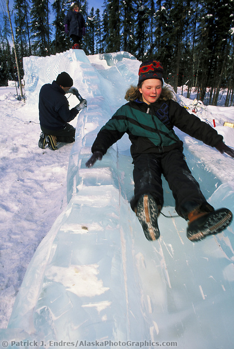 Kids play at the Ice Park during the World Ice Sculpting competition, Fairbanks, Alaska.