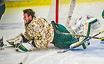 25 November 2014: University of Vermont Catamount Goaltender Brody Hoffman, a Junior from Wilkie, Saskatchewan, loses his mask on a play during the third period against the University of Massachusetts Minutemen at Gutterson Fieldhouse in Burlington, Vermont. The Cats defeated the Minutemen 3-1 to sweep the 2-game, home-and-away Hockey East Series. The 12th ranked Catamounts wore their camouflage uniforms for the evening to honor the US military. Mandatory Credit: Ed Wolfstein Photo *** RAW (NEF) Image File Available ***