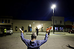 Residents of Greenwood, S.C. hold a prayer vigil in a parking lot downtown on Friday night as they ask God to cleanse their city of crime and sin.