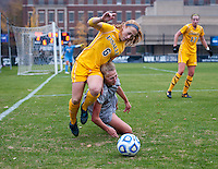 Grace Damaska (26) of Georgetown fights for the ball with Ashley Chilcoat (6) of La Salle during the first round of the NCAA tournament at Shaw Field in Washington, DC.  Georgetown defeated La Salle, 2-0.