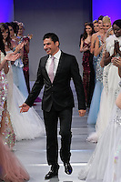 Dubai based fashion designer Walid Atallah, walks the runway with models, at the close of his Walid Atallah Spring Summer 2012 fashion show, during Couture Fashion Week Spring 2012.