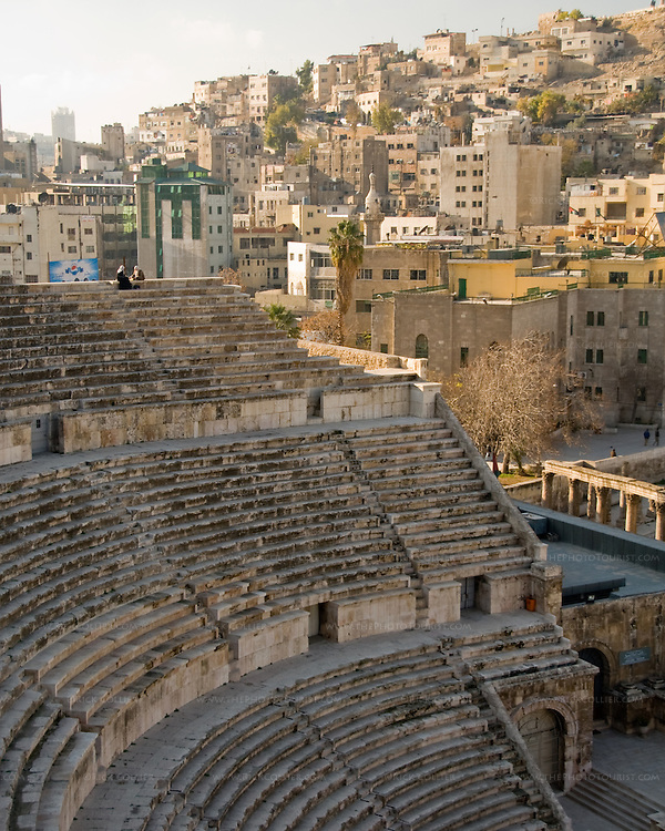 At the Theater.  Two women chat, seated at the top row of the Roman theater in the oldest, Islamic section of Amman, Jordan.  What is now Amman was once the city known in the classical world as Roman Philadelphia.  © Rick Collier