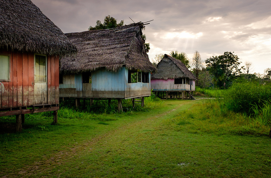 LORETO, PERU - CIRCA OCTOBER 2015:  Typical houses around the Ucayali river. Village of Puerto San Miguel in the Peruvian Amazon.