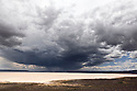 OR01343-00...OREGON - Storm clouds over the Alvord Desert.