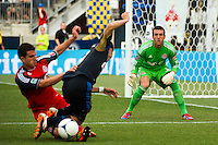 Toronto FC  goalkeeper Milos Kocic (30) watches as  Logan Emory (2) takes down Michael Farfan (21) of the Philadelphia Union. The Philadelphia Union defeated Toronto FC 3-0 during a Major League Soccer (MLS) match at PPL Park in Chester, PA, on July 8, 2012.