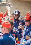 22 March 2015: Houston Astros first baseman Chris Carter returns to the dugout after scoring during Spring Training action against the Pittsburgh Pirates at Osceola County Stadium in Kissimmee, Florida. The Astros defeated the Pirates 14-2 in Grapefruit League play. Mandatory Credit: Ed Wolfstein Photo *** RAW (NEF) Image File Available ***