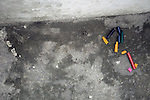 South America, Brazil. Rio de Janiero. Broken crayons on street of Vila Canoas favela.