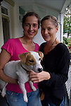 Full lenght portrait of Leigh and Helena outdoors on their front porch in Philadelphia<br /> <br /> Release # 2528