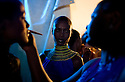 "Nigerian models prepare backstage for a show by African fashion designer Deola Sagoe during the July 13, 2008 leg of the ThisDay music and fashion festival in Lagos, Nigeria. The festival, themed ""Africa Rising"", aims to raise awareness of African issues while promoting positive images of Africa using music, fashion and culture in a series of concerts and events in Nigeria, the United States and the United Kingdom. ."
