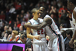 "Ole Miss' Marshall Henderson (22) is congratulated by Ole Miss' Murphy Holloway (31) at the C.M. ""Tad"" Smith Coliseum on Saturday, February 23, 2013. Mississippi won 88-55. (AP Photo/Oxford Eagle, Bruce Newman)"