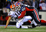 17 November 2008:  Cleveland Browns' quarterback Brady Quinn is hurried by Buffalo Bills defensive tackle Marcus Stroud at Ralph Wilson Stadium in Orchard Park, NY. The Browns defeated the Bills 29-27 in the Monday Night AFC matchup. *** Editorial Sales Only ****..Mandatory Photo Credit: Ed Wolfstein Photo