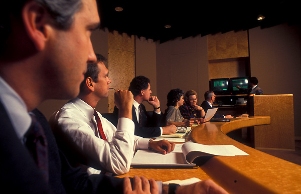 Stock photo of professionals watching a presentation in a business conference