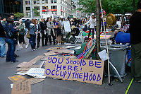 """You should be !here! Occupy the hood"" sign at the Occupy Wall Street Protest in New York City October 6, 2011."