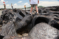 A group of conservationalists from Bogota check out an ancient lava flow in the middle of the Orinoco River - Orinoco River Basin - Venezuela/Colombia Border- South America