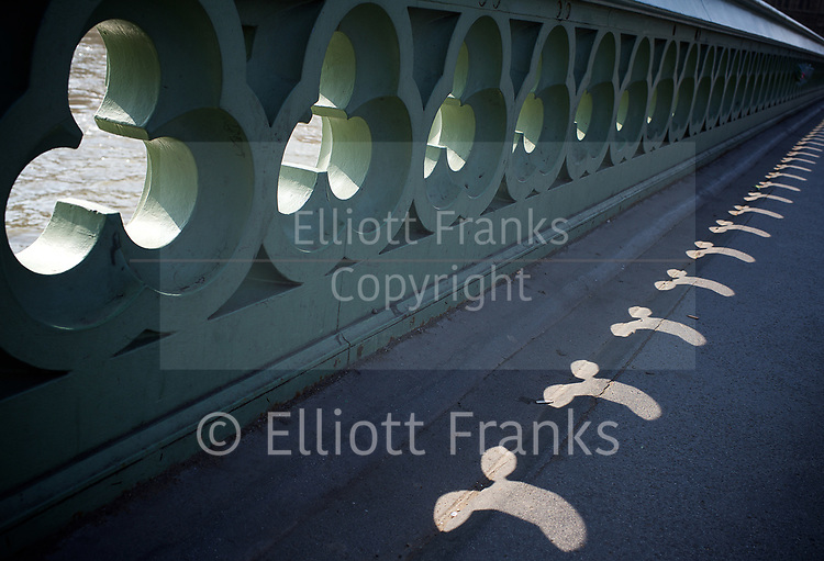 Westminster Bridge <br /> shafts of lights pour through the side of the bridge onto the pavement below. <br /> <br /> 27th March 2017 <br /> Westminster Bridge , London, Great Britain <br /> <br /> Photograph by Elliott Franks <br /> Image licensed to Elliott Franks Photography Services