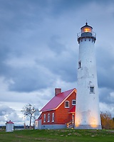 Tawas Point State Park, MI:  Stormy skies at Tawas Point Light (1853) on Tawas Point at dawn, Lake Huron - Iosco County