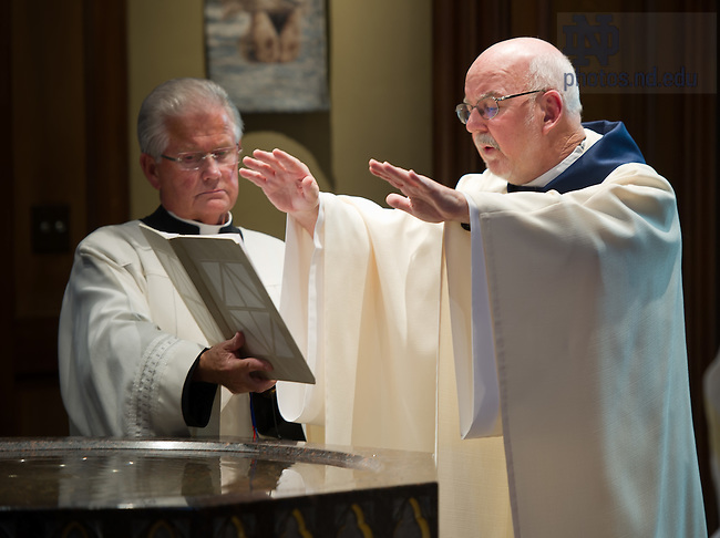 Aug. 25, 2012; Rev. Thomas O'Hara, C.S.C., Provincial Superior, blesses holy water in the Basilica of the Sacred Heart at the beginning of the Final Vows ceremony...Photo by Matt Cashore/University of Notre Dame