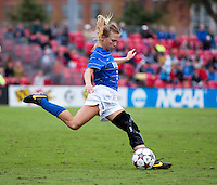 Kaitlyn Kerr (5) of Duke punts the ball forward at Ludwig Field on the campus of the University of Maryland in College Park, MD. DC. Duke defeated Maryland, 2-1.